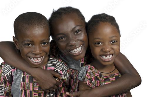 canvas print picture Drei afrikanische Kinder haben Spass
