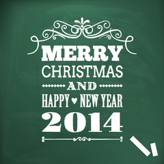 merry christmas and happy new year 2014 write on chlakboard