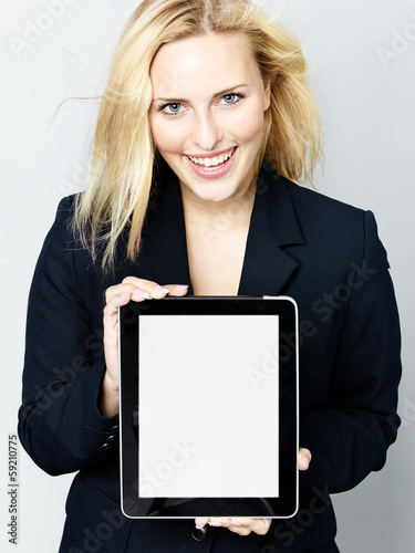 Business woman presenting her tablet with copyspace