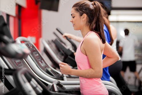 Beautiful brunette on a treadmill