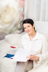 woman with  documents at home