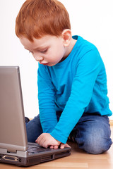 Child while exploring on laptop
