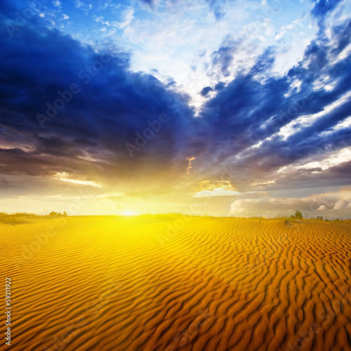 sandy desert at the dramatic sunset