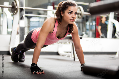Sticker Cute brunette working out at a gym