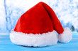 Christmas hat on table on light background