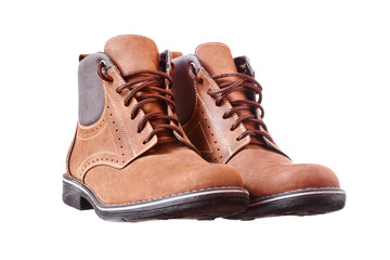 A pair of new brown hiking boots on white background