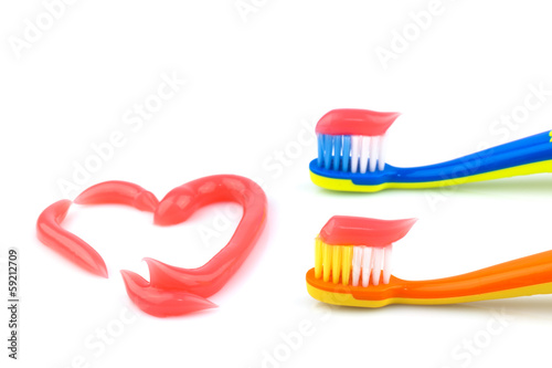 Toothbrushes with pink toothpaste