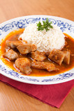 Fish goulash with rice and sauce