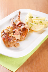 Marinated rabbit with bacon and boiled potatoes
