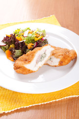 Chicken fillet with blue cheese and vegetables