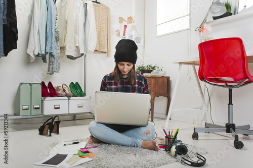 Casual blogger woman working in her fashion office.