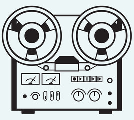 Reel tape recorder isolated on blue background