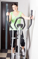 mature women on trainer machines at home