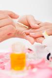 Manicurist Applying Nail Varnish poster