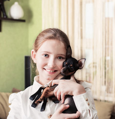 smile girl with toy terrier