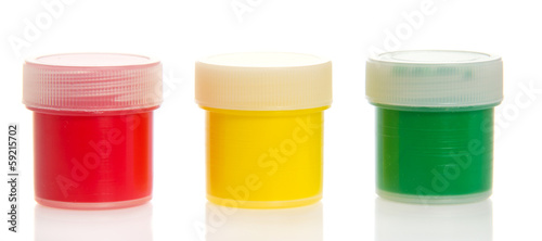 Bright paints in jars, close up