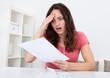 Sad Woman Reading Paper
