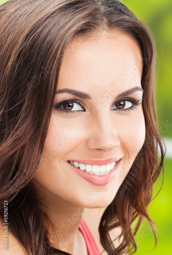 Happy smiling young woman, outdoors