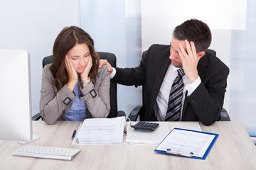 Worried Businesspeople Calculating Finance