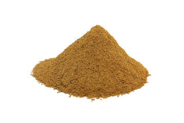 a handful of spicy ground cinnamon on a white background