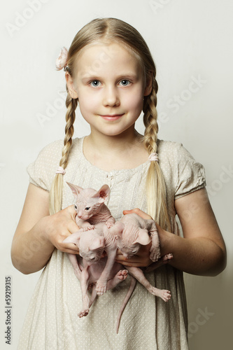 Girl with kittens, cute child with baby animals