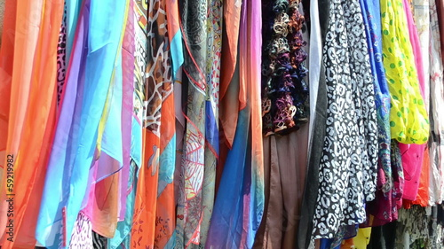 multicolor cloaks shawls and scarves sold in market fair