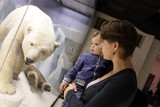 Mother with son and polar bear