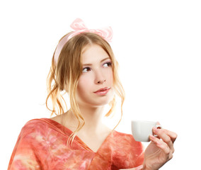 Young woman with pink bow and white coffee cup