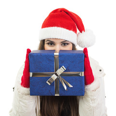 Young woman with Santa hat holding big blue gift box