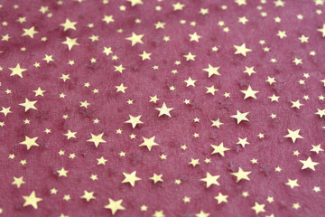 fabric grunge christmas background with stars pattern