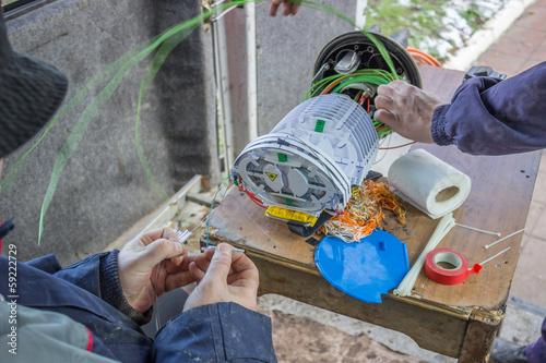 poster of Fibre optic technicians preparing fibres for splicing