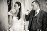 photo of bride and groom drinking champagne after toast