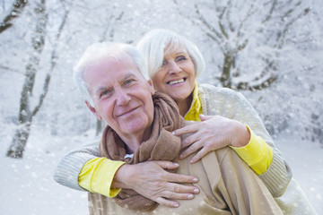 together in the cold wintertime senior couple