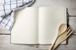 Leinwanddruck Bild - Blank recipe book on wooden table