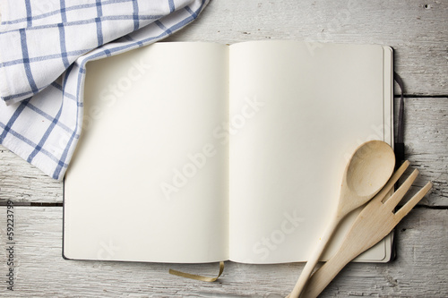 Leinwandbild Motiv Blank recipe book on wooden table