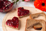 Sweet hearts made of bread with butter and blackberry jam