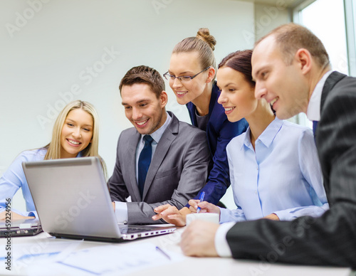 business team with laptop having discussion