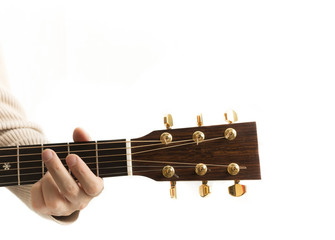 Close-up headstock of an acoustic guitar