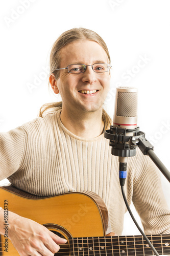 Smiling musician with his guitar