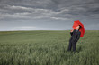 canvas print picture - Man with umbrella looking for rain