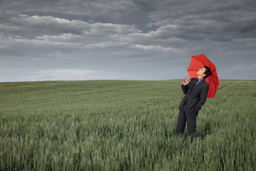 Man with umbrella looking for rain