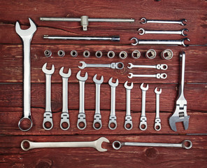 Stainless steel wrench set on wood background