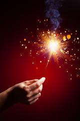 sparkler in hand