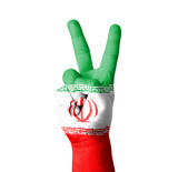 Hand making the V sign, Iran flag painted