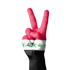 Hand making the V sign, Iraq flag painted