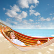 child relaxing in a hammock