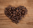 coffee beans on wooden background. heart