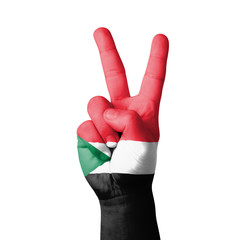 Hand making the V sign, Sudan flag painted