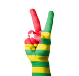 Hand making the V sign, Togo flag painted