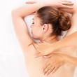 Woman having massage of body in spa salon